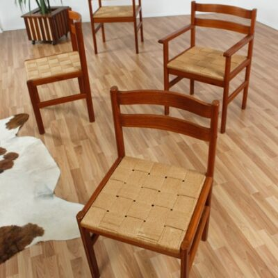 Set of four Danish teak mid century modern dining chairs with rush seats