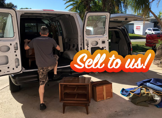 Loading mid-century modern furniture into a van