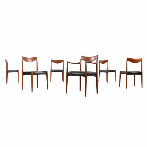 1950s Mid century modern teak Bambi Dining Chairs designed by Rolf Rastad and Adolf Relling for Gustav Bahus. New black vinyl upholstered seats