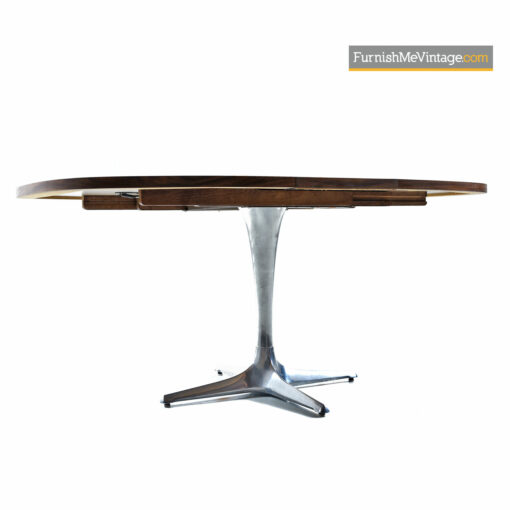 The Chromcraft Sculpta dining table accompanies the Unicorn Star Trek chairs designed by Vladimir Kagan.