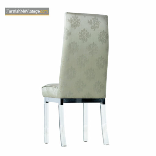 Set of four mid-century modern dining chairs with chrome trim and Lucite clear acrylic legs.