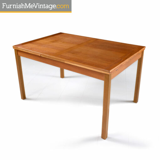 Ansager mid-century modern Danish teak draw leaf dining table. This table has two leaves at each end. Lift the table top and pull to extend the table top.