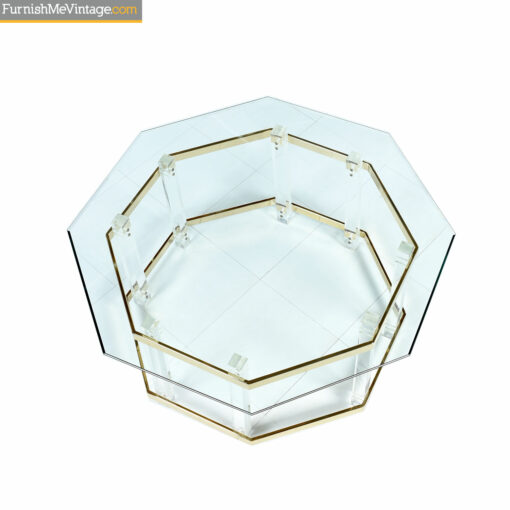 Gold and glass coffee table with lucite pillars