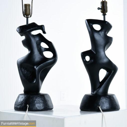 man woman black ceramic lamps