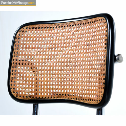 Caning on black and chrome chair