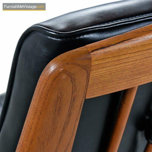 black naugahyde tufted lounge chair