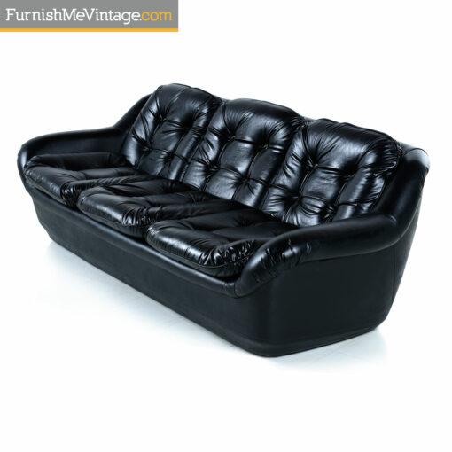 black tufted mid century modern sofa