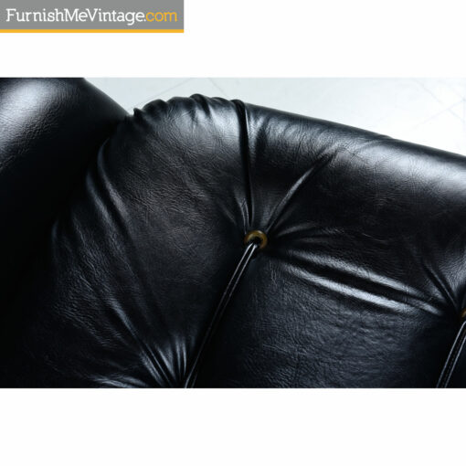 black tufted vinyl sofa roped buttons