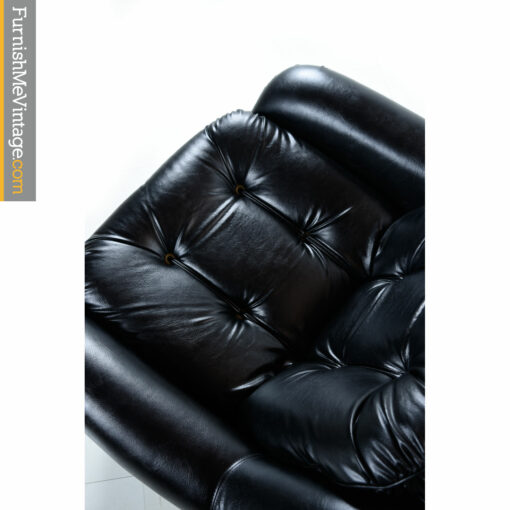 black vinyl tufted retro armchair