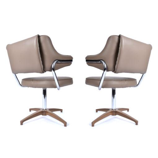 Beige and chrome swivel chairs