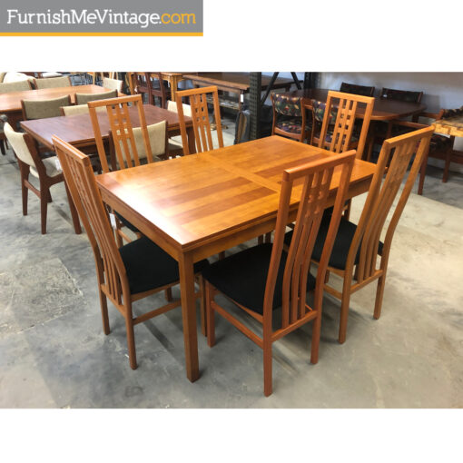 Danish cherry wood draw leaf expanding dining table