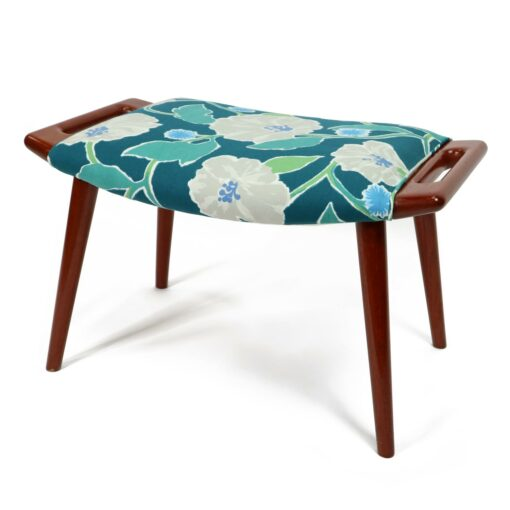 Iconic mid-century modern Papa Bear Chairs by Hans Wegner. The set comes with an ottoman as pictured and features floral teal, green and white fabric.
