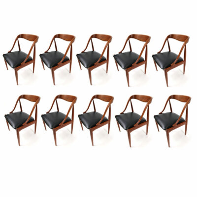 Johannes Andersen for Uldum Mobelfabrik set of 10 vintage 1960s Danish teak dining chairs. Exquisite mid-century modern design on beautifully aged teak.