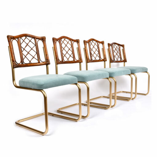 Restored vintage 1970s Bohemian rattan back dining chairs with matte gold cantilever steel frames and new blue velvet seats.