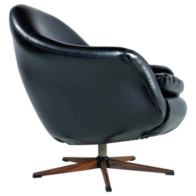 Black mid-century modern pod chair by Burris with rosewood base